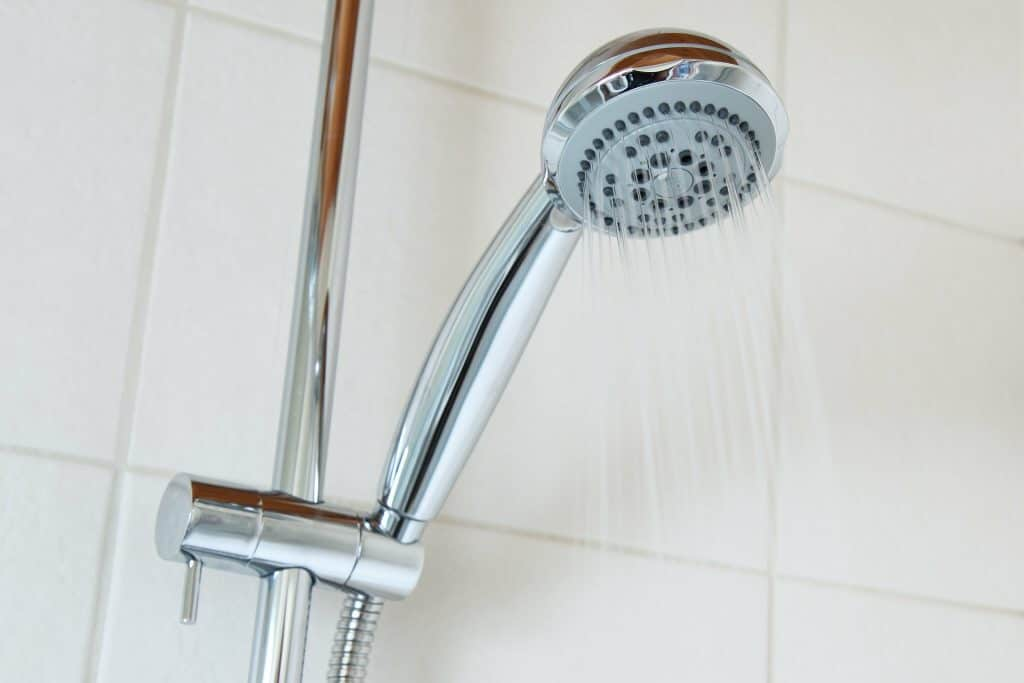 why shower head whistles