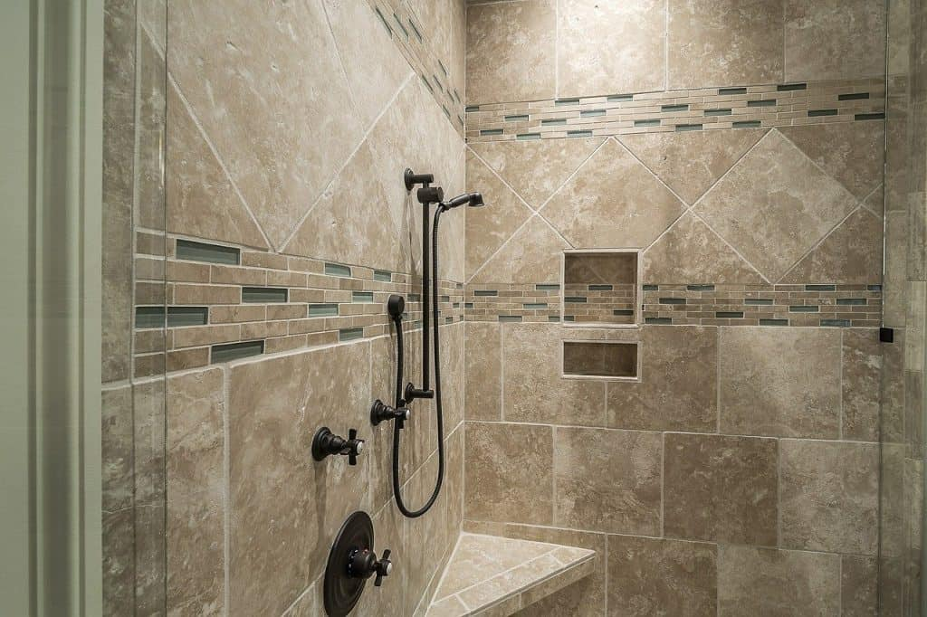 should bathroom tiles go to the ceiling shower pros wall